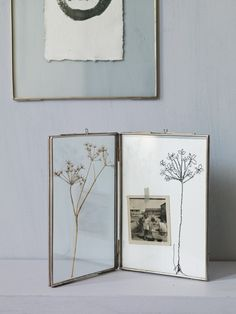 Hinged Glass Frame- Simply perfect. Whether you use it to display your favourite photographs, flowers or keepsakes, you will be sure to treasure this delicate metal-rimmed frame for many years to come.   £12.50  www.coxandcox.co.uk