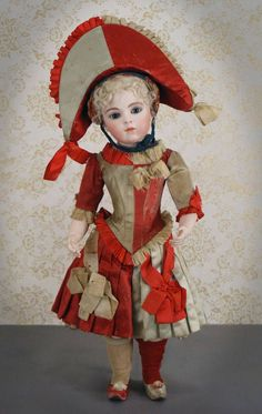 Making her entrance again with her usual flair, is a remarkable Bru Jeune 8 costumed as Mlle. Polichinelle. Her magnificent costume has to be one of the most-copied in the world by doll artisans, BUT, you'll have to come to The Grovian Doll Museum to see the real thing!
