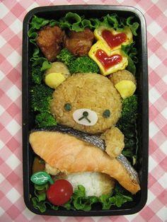 日本人のごはん/お弁当 Japanese meals/Bento. 熊がシャケ抱えてるという伝統的北海道土産な弁当。