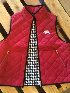 This is a crimsonhoundstooth exclusive. The quilted vest is THE fashion item for fall. It is made from nylon. See below for a size comparison. RTR small=4-6 medium=8-10 Large=12-14 xlarge=16-18 2xlarge=20 These fit differently than a comparable plus size vest. The plus vest will be larger in the waist for a more comfortable fit.  $29.99