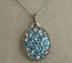5.04ct Blue Topaz with Black and White Diamonds in Oval Pendant, $2,600