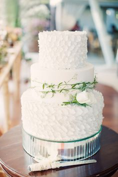 Gorgeous textured white wedding cake: http://www.stylemepretty.com/2015/02/04/colorful-cultural-bali-wedding/ | Photography: Erika Gerdemark - http://www.gerdemark.com/