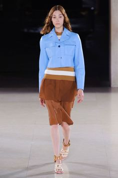 He color-blocked in a Seventies-smart light blue-white-brown palette. The idea was layered dressing—little jackets over knits over tunics over skirts.    - HarpersBAZAAR.com