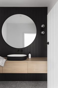 Dark joinery and pops of terrazzo steal the show in this modern home makeover. Black panel wall in powder room, cool powder room with round mirror, black sink in bathroom Home Design, Bath Design, Vanity Design, Powder Room Decor, Powder Room Design, Modern Powder Rooms, Modern Room, Small Powder Rooms, Modern Farmhouse Powder Room