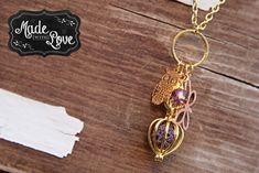 "PATIENCE.  Essential Oil diffusing necklace.  Super sassy gold with owl and butterfly charm and pink crystal bead.  Gold cage locket contains a purple lava diffusing stone.  Made by Made with Love...Accessorizing Essential Oils!!  Available for purchase in my Facebook ""SHOP"".  Like my page to see what else I have available for purchase!!"