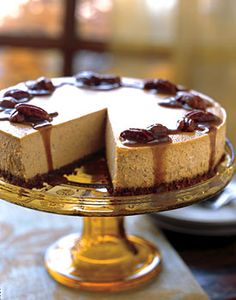 Spiced Pumpkin Cheesecake with Caramel-Bourbon Sauce