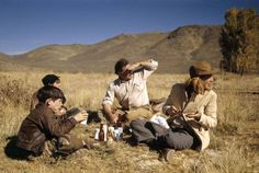 'Ernest Hemingway with his sons and his wife stop for a snack - Sun Valley, Idaho, USA by Robert Capa, 1941.