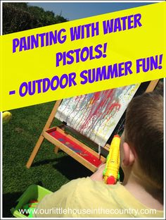 Painting with Water Pistols - More Messy Outdoor Summer Art Fun! - Our Little House in the Country #waterguns #waterpistols #summer #kidsact...