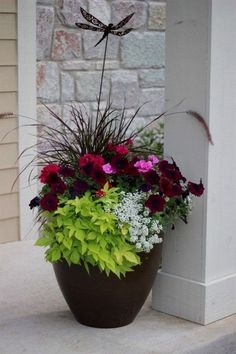 One way to beautify the entrance of your home is to place some flower pots close to the door. Here are several front door flower pots to inspire ... #frontdoorflower #flower #potflower