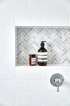 White subway tiles frame a gray marble herringbone tiled shower niche. Tile Shower Niche, White Subway Tile Shower, Gray Shower Tile, Bathroom Niche, Subway Tile Showers, Tiny House Bathroom, Bathroom Floor Tiles, Bathroom Renos, White Bathroom