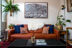 Vintage kilim pillows and mud cloth pillows on a custom-made couch.   → Get this…