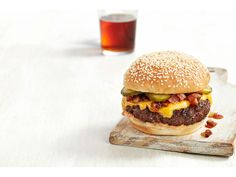 Bash Burgers recipe from Food Network Magazine. Uses diced bacon and a sriracha, mayo, ketchup sauce.