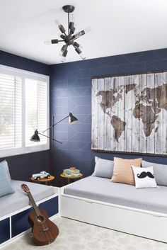 Blue and gray shared boys' room features a distressed wood map art piece mounted. Blue and gray shared boys' room features a distressed wood map art piece mounted on a wall covere Boys Bedroom Wallpaper, Gray Bedroom Walls, Boys Bedroom Decor, Bedroom Ideas, Baby Bedroom, Modern Boys Rooms, Shared Boys Rooms, Modern Room, Modern Playroom