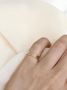 Our skinny stacking rings are classic and practical. These 14k gold circles are…