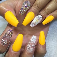 Looking for something good for your long nails? This amazing looking yellow inspired nail art design might just be the choice for you. With a combination of various intricate designs per nail and the wonderful bedazzled concept, you nails will surely look stunning.
