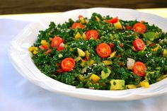 Raw Kale Salad  1 bunch kale (remove thick stems)    2 Tbsp lemon juice    2 Tbsp coconut aminos, braggs, or soy sauce    1 Tbsp maple syrup    1 tsp sesame oil    1 escallion finely chopped    2-3 cloves of garlic, minced    1 tsp sea salt    2 tsp ginger, grated    1 avocado, diced    ½ red bell pepper    ½ yellow bell pepper    ½ red onion, diced    ½ red cherry tomatoes  sesame seeds to garnish