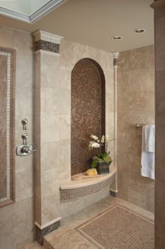 Interior designer Jim Walters created a Roman-style shower area styled like an outdoor pavilion. Tile columns at four corners support a pyramid skylight that opens electronically and floods the space with sunshine.