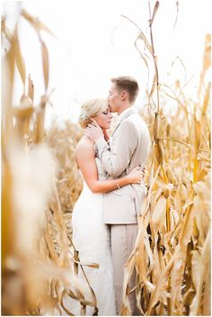 Wedding photography inspiration for a rustic midwest. Romantic and creative shot of the bride and groom in the middle on a corn field!
