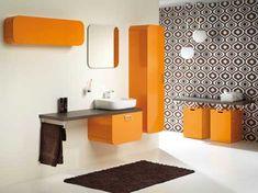 """Tiger badkamers Bruin en oranje Met een knipoog naar de 60-er jaren introduceert Tiger retro design in een modern jasje: badkamermeubilair """"Ontario"""" kenmerkt zich door robuuste, afgeronde vormen gecombineerd met een elegante belijning. Het meubilair maakt onderdeel uit van een badkamer totaalconcept en is verkrijgbaar in de hoogglans kleuren wit, oranje en bruin. Meer info: http://www.wonenwonen.nl/sanitair/tiger-badkamers/1554"""