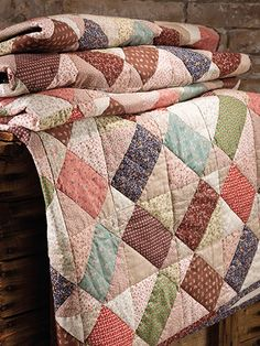"If you have contrasting scraps on hand you can make this quilt! Take all your favorite leftovers from past projects and you will have all you need to create this bed quilt! Finished size is 60"" x 90"". Skill Level: Confident Beginner"