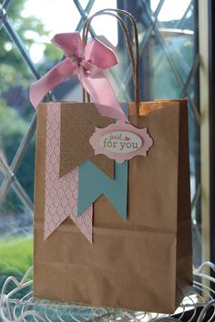DIY Decorated Gift bags ~ Cute way to reuse shopping bags.just cover the logo with more paper then add cute accents Paper Gift Bags, Paper Gifts, Diy Paper, Kraft Paper, Creative Gift Wrapping, Creative Gifts, Pretty Packaging, Gift Packaging, Craft Gifts