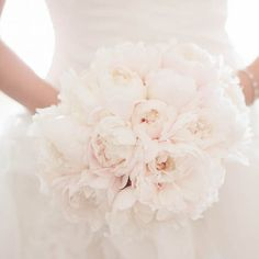 We've rounded up some of our favorite white wedding bouquets with a few tips for crafting your own. (Brandon Wong Photography)