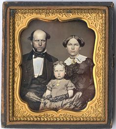Brooklyn Family - Mother and daughter are beautifully dressed and coiffed, but dad didn't get time to brush his hair.