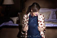 Monica Tand wearing Maria Marinescu dress and coat and Giorgio Armani earrings.