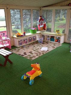Our Playroom in the Sunroom! Organization using Ikea Expedit shelving.  Makes for great toy storage and seating!