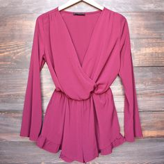 front wrap romper with ruffle hem in mulberry