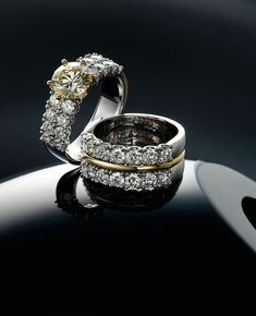 two 18k white and yellow gold diamond rings