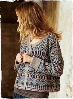 Motifs from an Indonesian ceremonial cloth pattern the cropped, boxy cardigan. Fair Isle knit with drop shoulders and ribbed turn-back cuffs in muted jeweltones of pima (37%), baby alpaca (33%), nylon (27%) and wool (3%).                                                                                                                                                                                 More