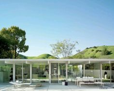 Eichler, glass wall, exterior overhang long enough to be an outdoor room.