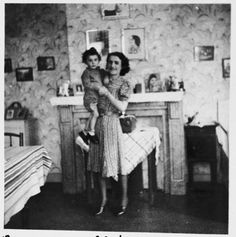 A Jewish mother holds her young son in their apartment in Brussels, where they are living in hiding as Christians.  Pictured are Leah and Nathan (Nounou) Ciechanow. They were subsequently deported to their death in Auschwitz.