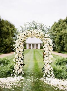 Elegant White Rose Ceremony Arch photography by katiestoops
