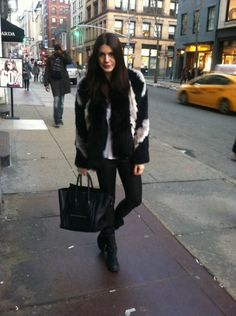 ON THE STREETS OF NEW YORK: Vera Wang boots, leather leggings, Theory fur jacket & celine bag. Click here for more pics: http://thestylenet.net/blog/2013/02/14/style-diaries-streets-new-york#