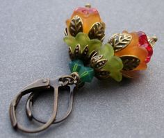 Flower Bud Earrings - Colorful Lucite and Brass Lever Backs by Karin Allie, via Etsy.      I really love this color combination.