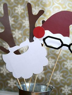 how cute to do a photo booth during the class holiday party and use these as props!