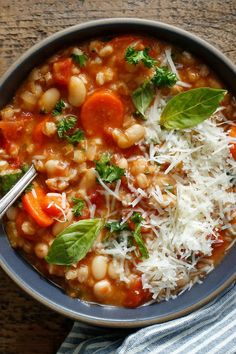 Tuscan Farro Soup - NYT Cooking: Simple yet amazing. This healthy soup, a kind of minestrone with farro, is ubiquitous in Lucca, a city in Tuscany. The farro is traditional, but you could use spelt or barley with good results. Farro Soup Recipe, Farro Recipes, Vegetarian Recipes, Cooking Recipes, Healthy Recipes, Cooking Videos, Cooking Pork, Cooking Tips, Cooking Classes