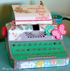 Need a gift for family or friend?  Why not give it in a unique box!   Check out Sharalyn's super adorable 3D Typewriter from the GOOD DAY AT THE OFFICE SVG KIT.  Bright colors, beautiful prints and so fun to look at!   The top comes off so you can put goodies inside!  They'll be surprised, for sure!
