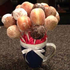 Donut hole bouquet in a coffee mug.