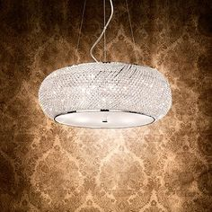 PASHA' SP10 - Ideal Lux Metal frame. Diffuser consisting of lines of cut crystal pearls. Bottom part closed by a round, sandblasted glass. Steel cables adjustable in length with an automatic device.