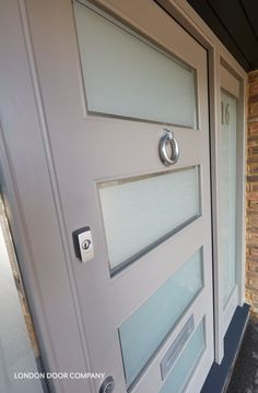 This stunning modern grey front door is made from high-performance, high quality Accoya.