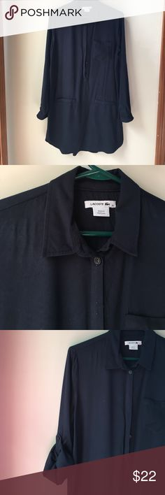 Lacoste shirt dress Viscose, navy in color, popover style with buttons partway down the front, sleeves have roll-up tabs; slightly longer in the back than the front with a curved hem; size 42 - according to Lacoste's website this is a 10, but would work better for a 6-8; good condition- there is some shine in the fabric from ironing, especially on the left front near the shoulder;50% of my pmark earnings go to New Hope Girls, a school in the DR. Lacoste Dresses Mini