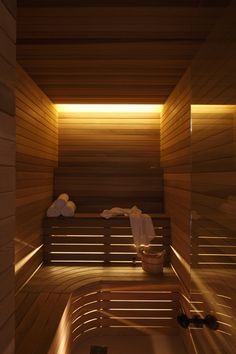 Sauna with curved corner seating.