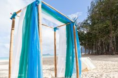<3 the sea glass colors on this destination wedding ceremony arch | Photo by http://modernromance.ca Flowers and ceremony setup by http://alohaislandweddings.com
