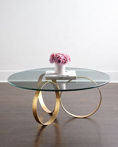 Naples Coffee Table at Horchow. Love the repeat of circles and no edges to bang into kids!