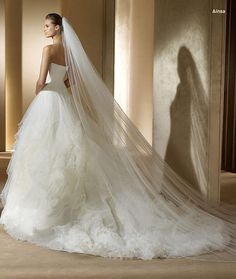 A bustle is in order for any Ragtime wedding dress!
