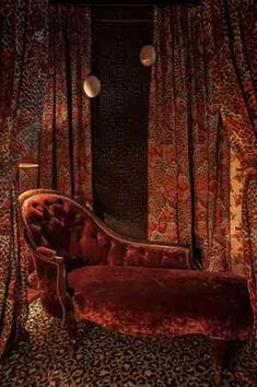 Red velvet chaise lounge.