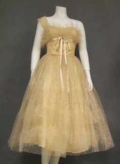 A wonderful 1950's prom dress in beige tulle with sparkling gold embroidery.